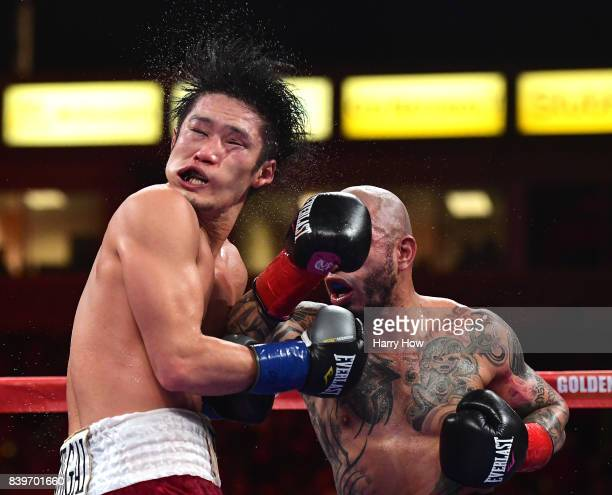 Yoshihiro Kamegai takes a punch from Miguel Cotto in a 12 round unanimous decision Cotto victory during the WBO Junior Middleweight title fight at...