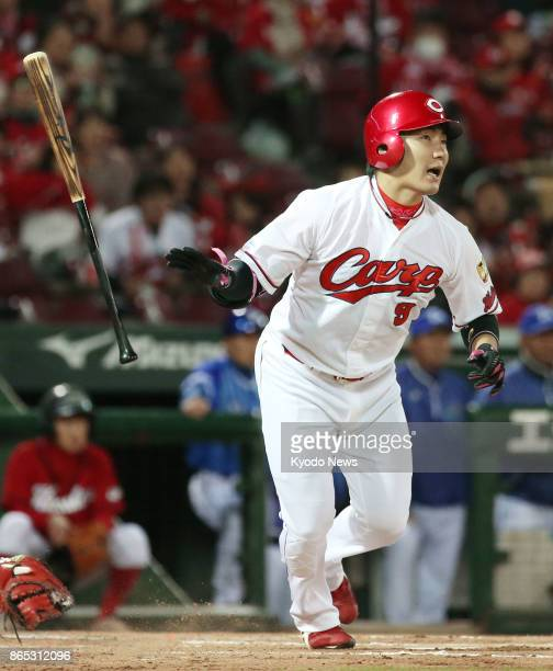 Yoshihiro Maru of the Hiroshima Carp hits a tworun homer in the first inning against the DeNA BayStars in a Central League Climax Series finalstage...