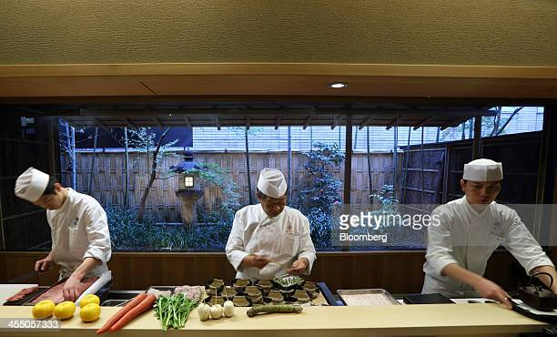 Yoshihiro Murata master chef for Kikunoi Japanese restaurant and chairman of the Japanese Culinary Academy center cooks in the restaurant kitchen...