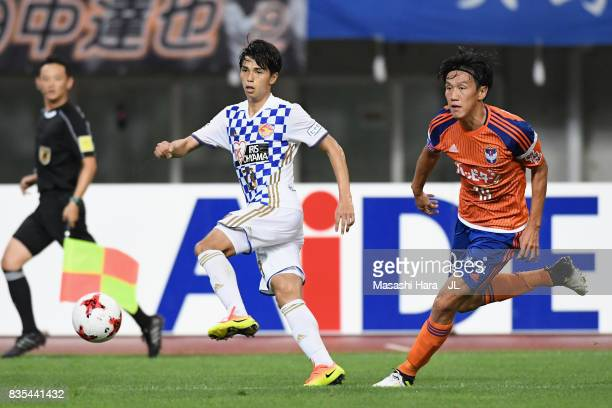 Yoshihiro Nakano of Vegalta Sendai and Kisho Yano of Albirex Niigata compete for the ball during the JLeague J1 match between Albirex Niigata and...