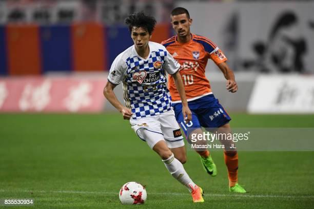 Yoshihiro Nakano of Vegalta Sendai controls the ball under pressure of Thiago Galhardo of Albirex Niigata during the JLeague J1 match between Albirex...