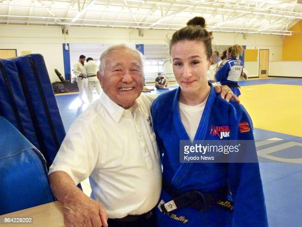Yoshihiro Uchida coach of the US judo team at the 1964 Tokyo Olympics poses for a photo alongside his charge Marti Malloy a bronze medalist in the...