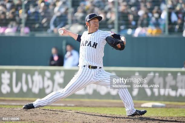 Yoshihisa Hirano of Samurai Japan pitches in the seventh inning during the SAMURAI JAPAN Friendly Opening Match between SAMURAI JAPAN and Fukuoka...