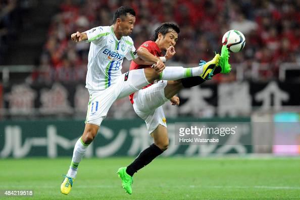Yoshihito Fujita of Shonan Bellmare and Daisuke Nasu of Urawa Red Diamonds compete for the ball during the JLeague match between Urawa Red Diamonds...