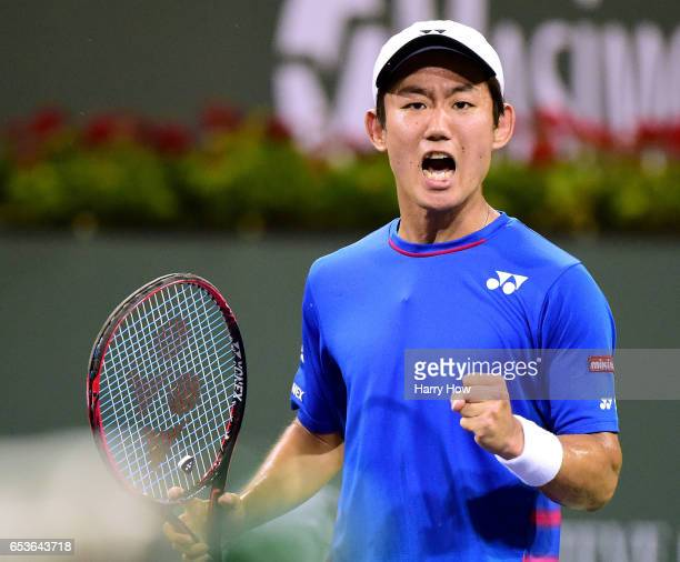 Yoshihito Nishioka of Japan celebrates a point as he loses to Stan Wawrinka of Switzerland during the BNP Paribas at Indian Wells Tennis Garden on...