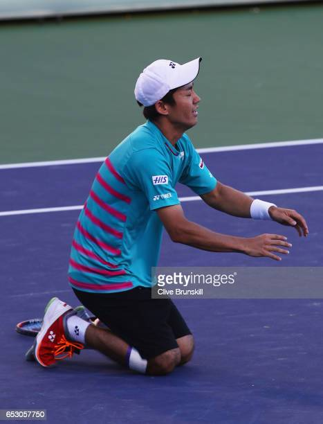 Yoshihito Nishioka of Japan celebrates match point in his third round match against Tomas Berdych of the Czech Republic during day eight of the BNP...