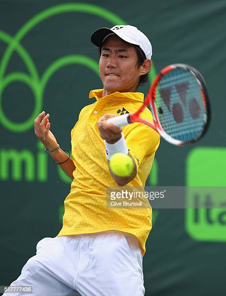Yoshihito Nishioka of Japan in action against Dominic Thiem of Austria in their third round match during the Miami Open Presented by Itau at Crandon...