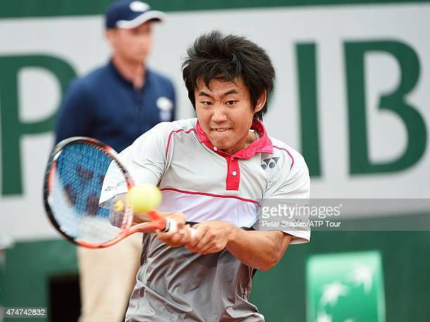 Yoshihito Nishioka of Japan in action against Tomas Berdych of Czech Republic at the French Open Roland Garros Stadium on May 25 2015 in Paris France