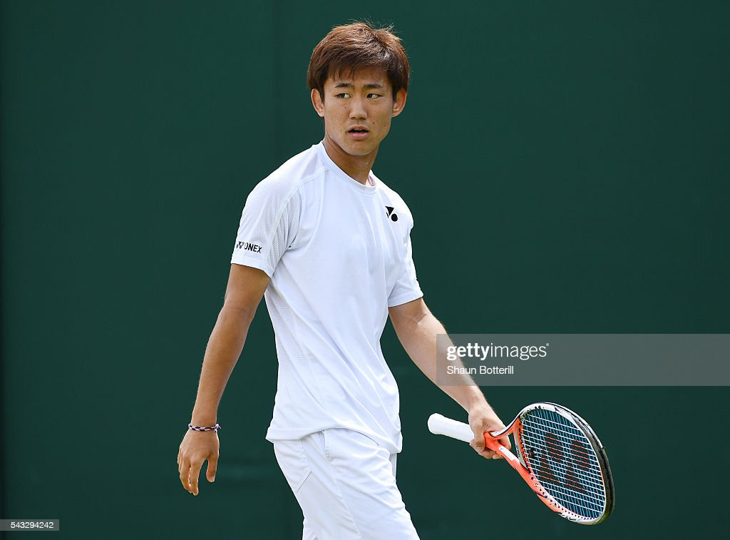 <a gi-track='captionPersonalityLinkClicked' href=/galleries/search?phrase=Yoshihito+Nishioka&family=editorial&specificpeople=9451757 ng-click='$event.stopPropagation()'>Yoshihito Nishioka</a> of Japan looks on during the Men's Singles first round match against Sergiy Stakhovsky od Ukraine on day one of the Wimbledon Lawn Tennis Championships at the All England Lawn Tennis and Croquet Club on June 27th, 2016 in London, England.