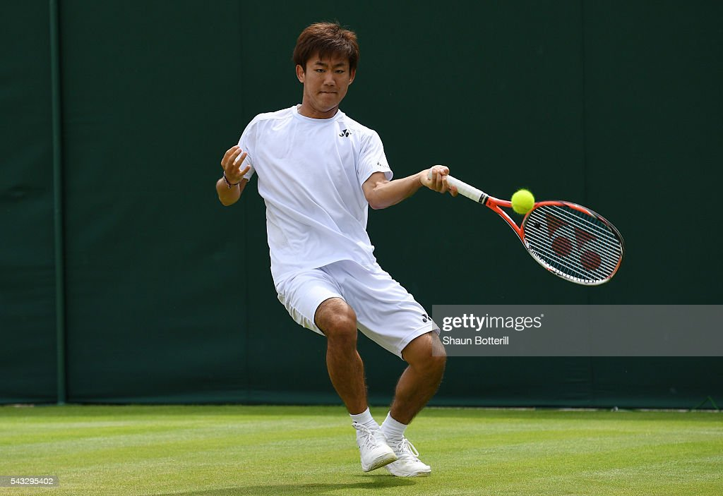 <a gi-track='captionPersonalityLinkClicked' href=/galleries/search?phrase=Yoshihito+Nishioka&family=editorial&specificpeople=9451757 ng-click='$event.stopPropagation()'>Yoshihito Nishioka</a> of Japan plays a forehand shot during the Men's Singles first round match against Sergiy Stakhovsky od Ukraine on day one of the Wimbledon Lawn Tennis Championships at the All England Lawn Tennis and Croquet Club on June 27th, 2016 in London, England.