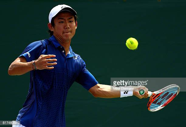 Yoshihito Nishioka of Japan plays a match against Feliciano Lopez of Spain during Day 5 of the Miami Open presented by Itau at Crandon Park Tennis...