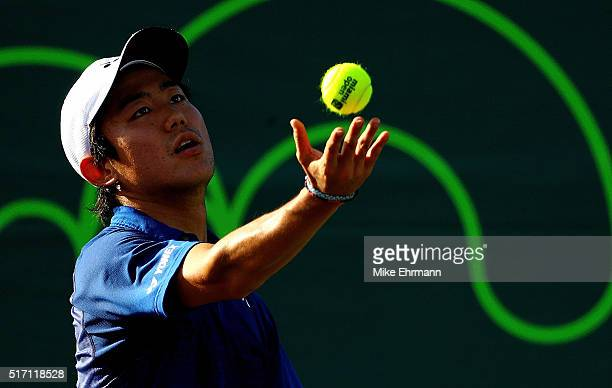Yoshihito Nishioka of Japan plays a match against Jared Donaldson during Day 3 of the Miami Open presented by Itau at Crandon Park Tennis Center on...