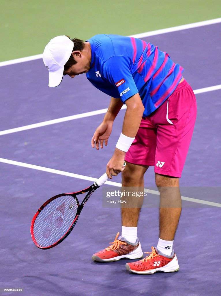 Yoshihito Nishioka of Japan reacts to his missed volley as he loses to Stan Wawrinka of Switzerland during the BNP Paribas at Indian Wells Tennis Garden on March 15, 2017 in Indian Wells, California.
