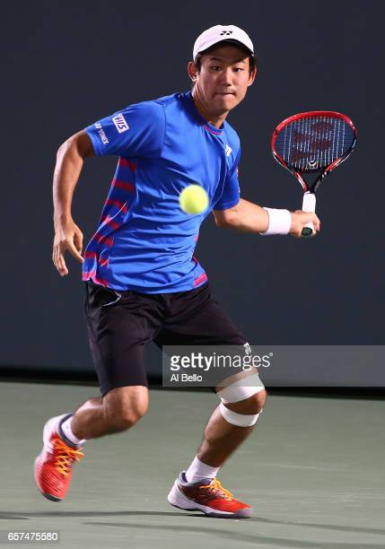 Yoshihito Nishioka of Japan returns a shot against Jack Sock during day 5 of the Miami Open at Crandon Park Tennis Center on March 24 2017 in Key...