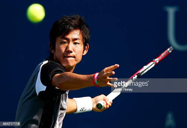 Yoshihito Nishioka of Japan returns a shot against Paolo Lorenzi of Italy during their men's singles first round match on Day Two of the 2014 US Open...