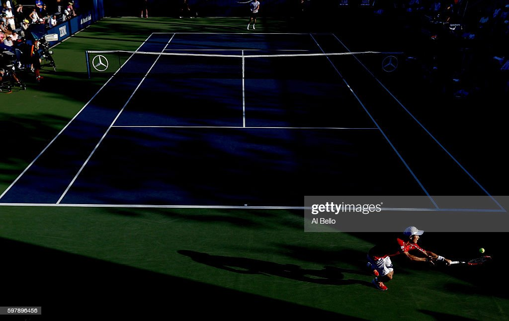 Yoshihito Nishioka of Japan returns a shot to Kevin Anderson of South Africa during his first round Men's Singles match on Day One of the 2016 US Open at the USTA Billie Jean King National Tennis Center on August 29, 2016 in the Flushing neighborhood of the Queens borough of New York City.