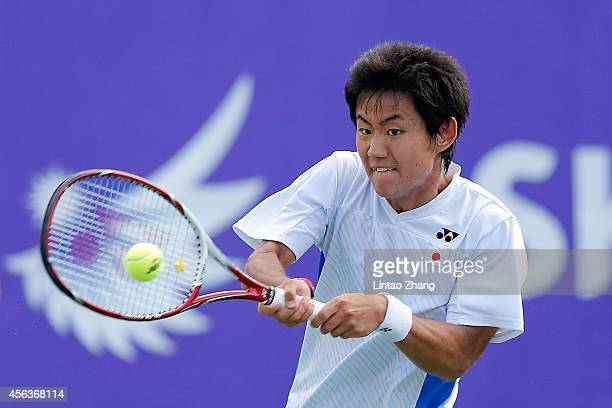 Yoshihito Nishioka of Japan returns a shot to Lu Yen Hsun of Chinese Taibei during the Tennis Men's Singles Gold Medal Match on day eleven of the...