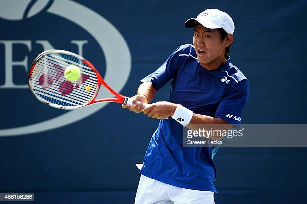 Yoshihito Nishioka of Japan returns a shot to PierreHugues Herbert of France during their Men's Singles Second Round match on Day Two of the 2015 US...