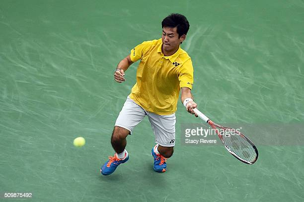 Yoshihito Nishioka of Japan returns a shot to Sam Querrey of the United States during their quarterfinal singles match on Day 5 of the Memphis Open...