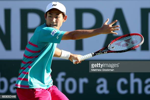 Yoshihito Nishioka of Japan returns a shot to Tomas Berdych of Czech Republic during the BNP Paribas Open at the Indian Wells Tennis Garden on March...