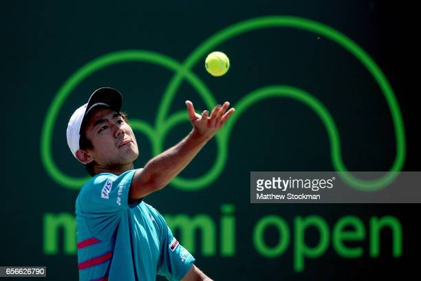 Yoshihito Nishioka of Japan serves to Jordan Thompson of Australia during the Miami Open at the Crandon Park Tennis Center on March 22 2017 in Key...