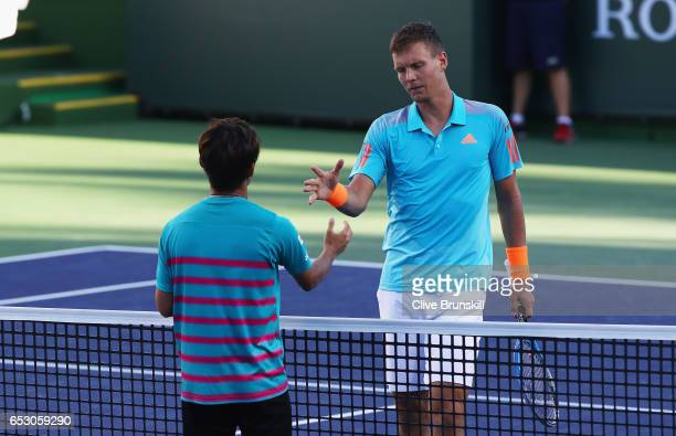 Yoshihito Nishioka of Japan shakes hands at the net after his three set victory in his third round match against Tomas Berdych of the Czech Republic...