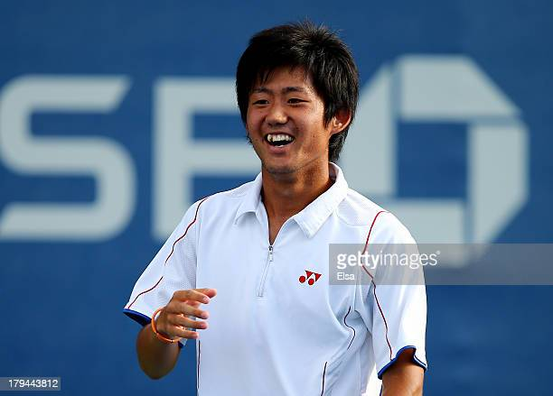 Yoshihito Nishioka of Japan smiles next to his partner Jorge Panta of Peru during their boys' doubles first round match against Gerardo Lopez...
