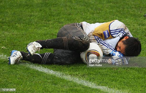 Yoshikatsu Kawaguchi grimaces after hurting his hand during a Japan training session at Outeniqua Stadium on June 9 2010 in George South Africa