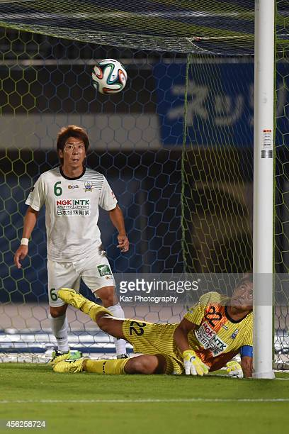 Yoshikatsu Kawaguchi of FC Gifu keeps the ball off the line while Keiji Takachi of FC Gifu watches the save during the J League second division match...