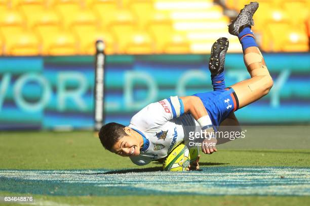Yoshikazu Fujita of the Panasonic Wild Knights scores a try during the Rugby Global Tens match between Wild Knights and Rebels at Suncorp Stadium on...