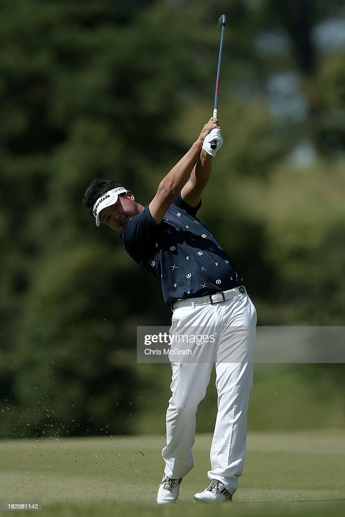 Yoshikazu Haku of Japan plays his second shot on the fourth hole during day three of the Panasonic Japan Open at Ibaraki Golf Club on September 28, 2013 in Ibaraki, Japan.
