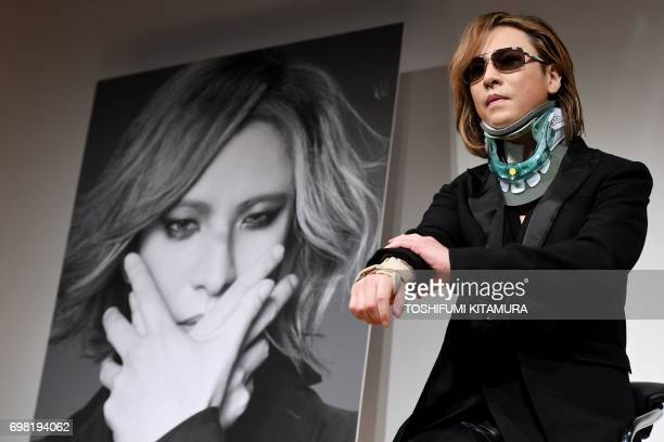 Yoshiki from the Japanese band 'X Japan' wears a neck brace while attending a press conference for his world tour concert in Tokyo on June 20 2017...