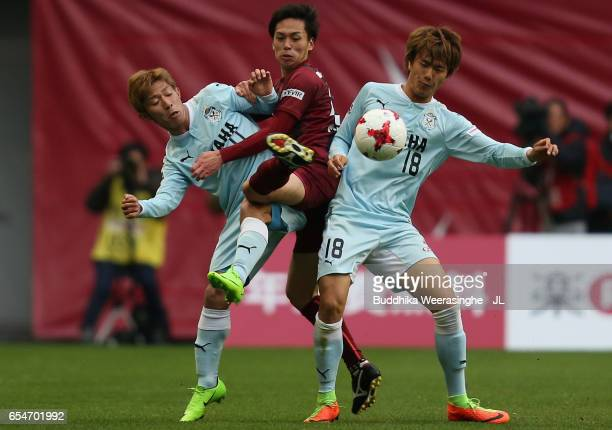 Yoshiki Matsushita of Vissel Kobe competes for the ball against Takuya Matsuura and Koki Ogawa of Jubilo Iwata during the JLeague J1 match between...