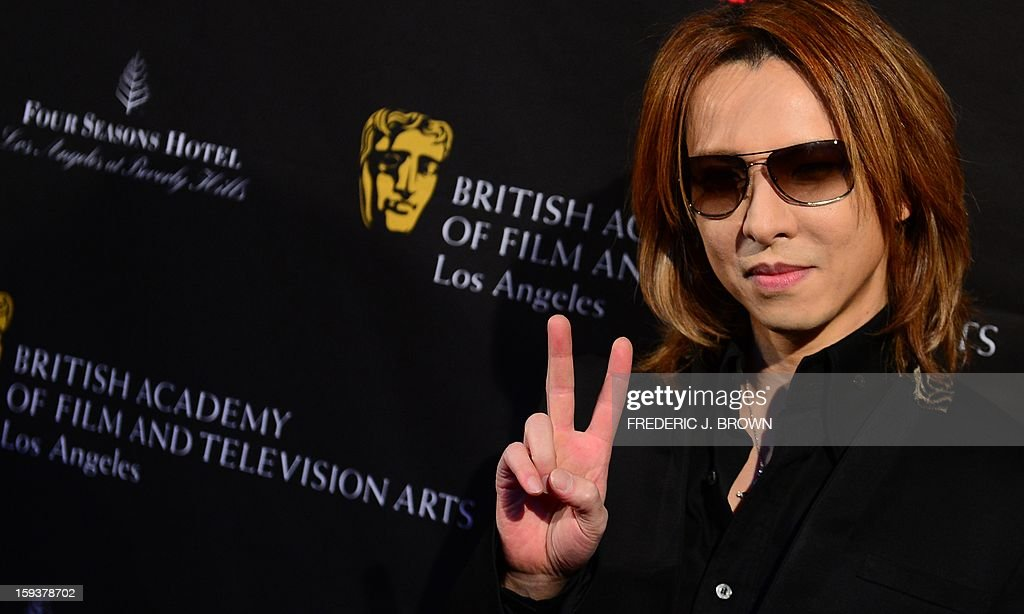 Yoshiki poses on arrival for the British Academy of Film and Television Arts (BAFTA) Los Angeles Awards Season Tea Party on January 12, 2013 in Beverly Hills, California. AFP PHOTO / Frederic J. BROWN