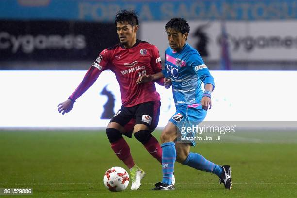 Yoshiki Takahashi of Sagan Tosu and Hotaru Yamaguchi of Cerezo Osaka compete for the ball during the JLeague J1 match between Sagan Tosu and Cerezo...