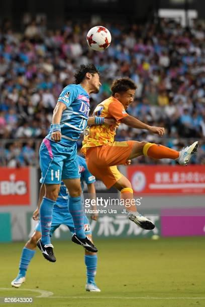 Yoshiki Takahashi of Sagan Tosu and Shota Kaneko of Shimizu SPulse compete for the ball during the JLeague J1 match between Sagan Tosu and Shimizu...