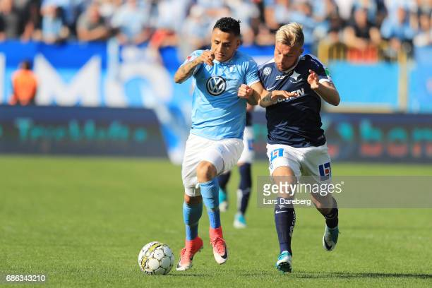 Yoshimir Yotún of Malmo FF and Nicklas Barkroth of IFK Norrkoping during the Allsvenskan match between Malmo FF and IFK Norrkoping at Swedbank...