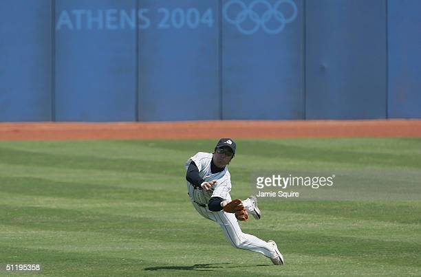 Yoshinobu Takahashi of Japan makes a diving catch in the baseball preliminary game against Canada on August 20 2004 during the Athens 2004 Summer...