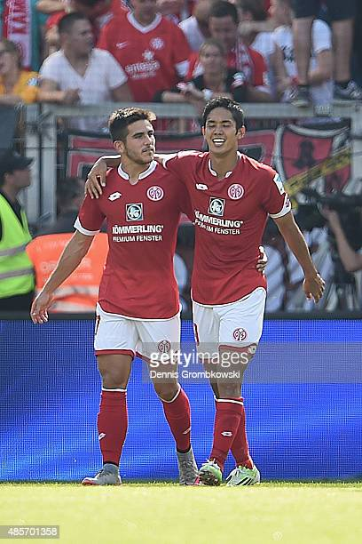 Yoshinori Muto of 1 FSV Mainz 05 celebrates as he scores the second goal during the Bundesliga match between 1 FSV Mainz 05 and Hannover 96 at Coface...