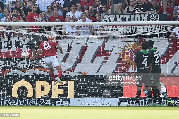 Yoshinori Muto of 1 FSV Mainz 05 heads the second goal during the Bundesliga match between 1 FSV Mainz 05 and Hannover 96 at Coface Arena on August...