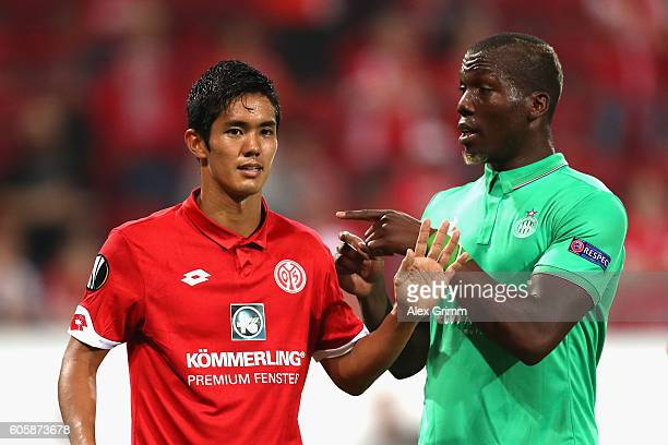Yoshinori Muto of FSV Mainz 05 and Florentin Pogba of SaintEtienne in conversation during the UEFA Europa League Group C match between 1 FSV Mainz 05...