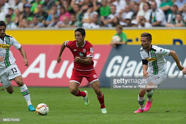 Yoshinori Muto of FSV Mainz 05 driving the ball at Borussia Park on August 23 2015 in Moenchengladbach Germany