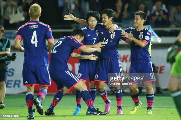 Yoshinori Muto of Japan celebrates his goal with team mates during the KIRIN CHALLENGE CUP 2014 international friendly match between Japan and...