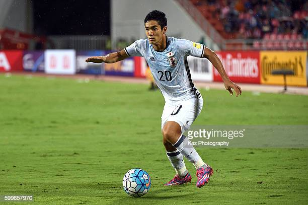 Yoshinori Muto of Japan dribbles during the 2018 FIFA World Cup Qualifier between Thailand and Japan at the Rajamangala National Stadium on September...