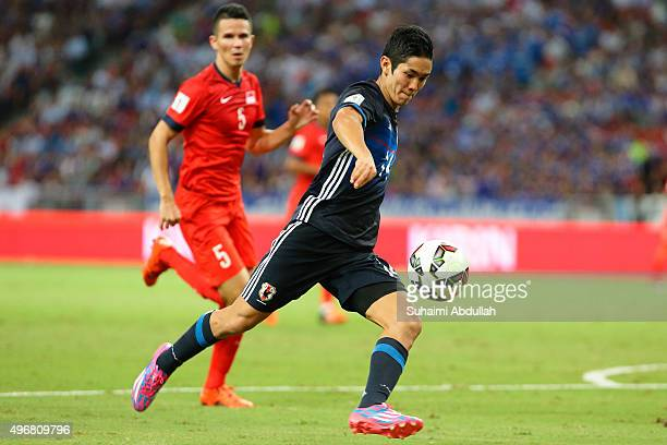 Yoshinori Muto of Japan lines up a shot during the 2018 FIFA World Cup Qualifier match between Singapore and Japan at National Stadium on November 12...