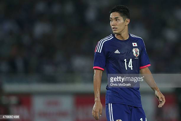 Yoshinori Muto of Japan watches on during the international friendly match between Japan and Iraq at Nissan Stadium on June 11 2015 in Yokohama Japan