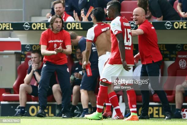 Yoshinori Muto of Mainz celebrates his team's third goal with head coach Martin Schmidt during the Bundesliga match between 1 FSV Mainz 05 and...