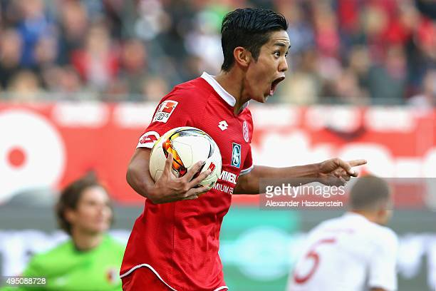 Yoshinori Muto of Mainz celebrates scoring the 2nd team goal during the Bundesliga match between FC Augsburg and 1 FSV Mainz 05 at WWK Arena on...