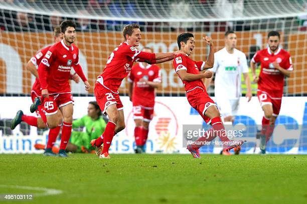 Yoshinori Muto of Mainz celebrates scoring the 3rd team goal during the Bundesliga match between FC Augsburg and 1 FSV Mainz 05 at WWK Arena on...