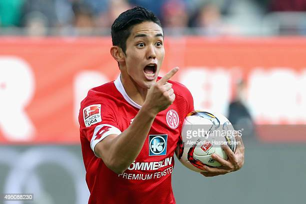 Yoshinori Muto of Mainz celebrates scoring the opening goal during the Bundesliga match between FC Augsburg and 1 FSV Mainz 05 at WWK Arena on...